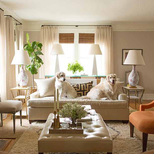 living room with tufted ottoman