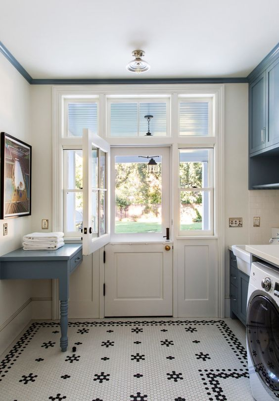 laundry room with black and white tile