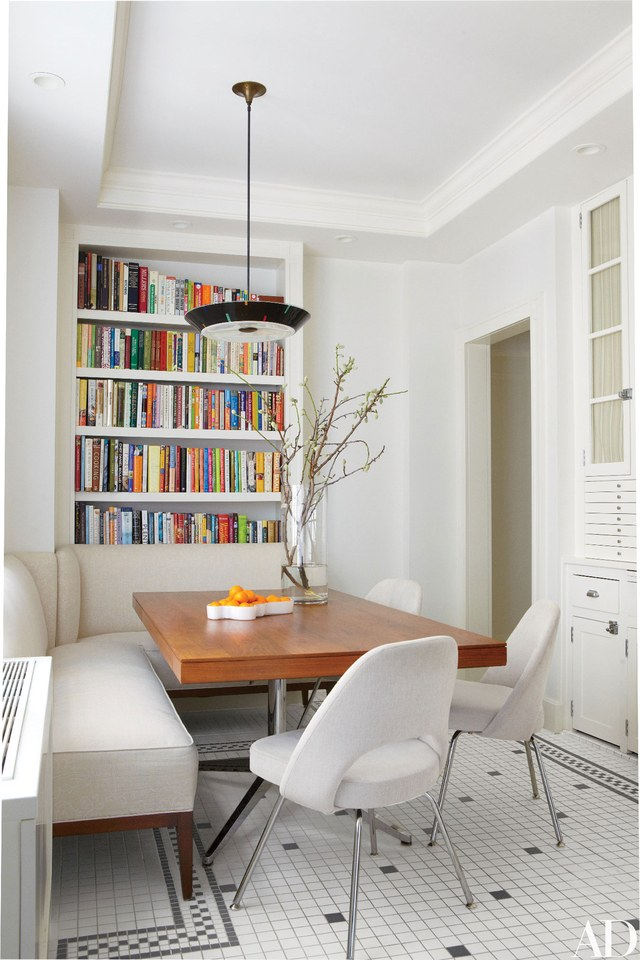 banquettes in dining room with bookcase