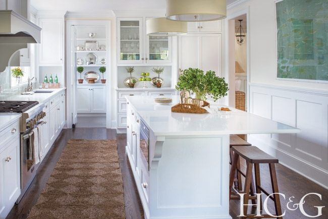 welcome to this white kitchen with seagrass rug