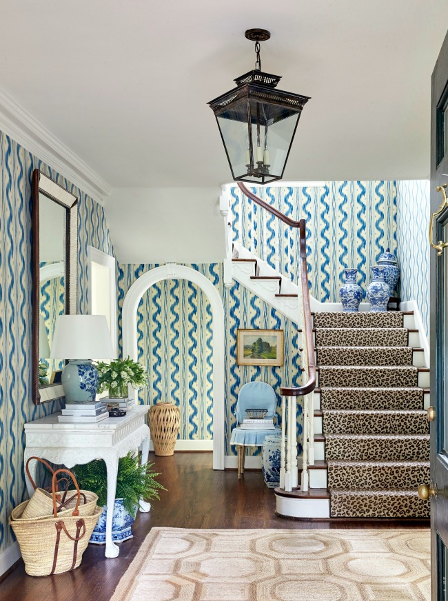 home Sarah Bartholomew entry with blue and white Quadrille wallpaper