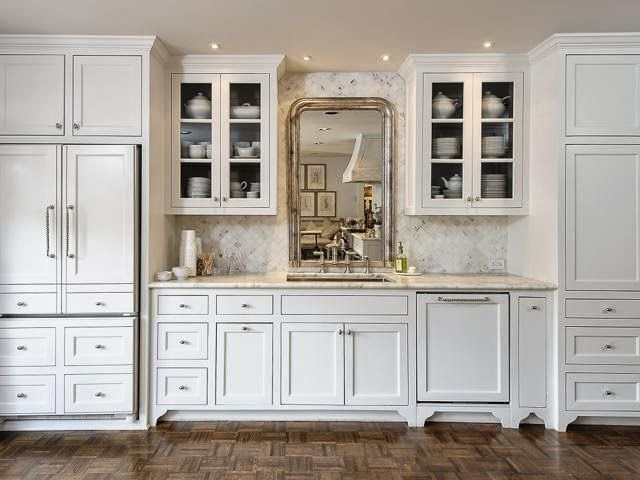 wood cabinets and mirror in kitchen - heart of the home