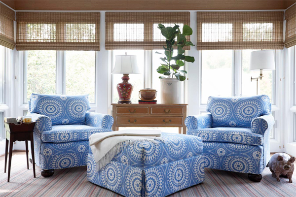 Blue and white sitting room with woven blinds