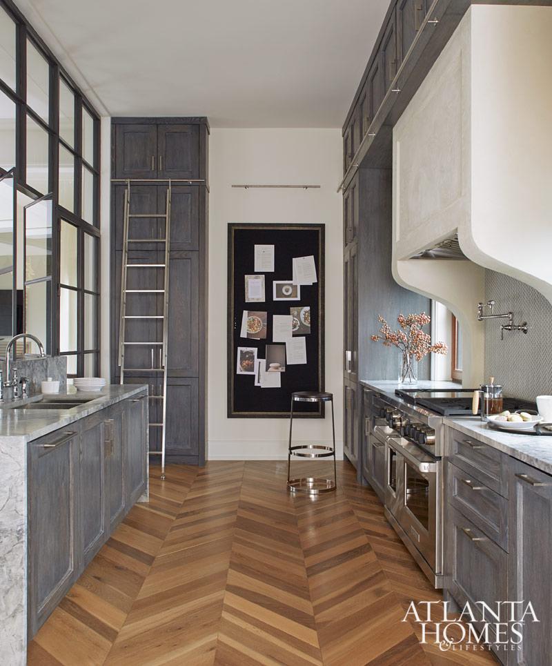gray kitchen with herringbone floors