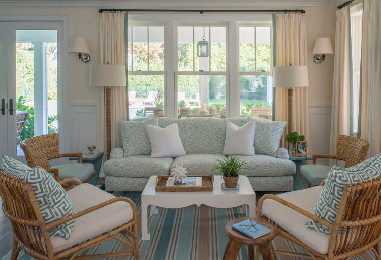welcome to this living room in blue and white and wicker