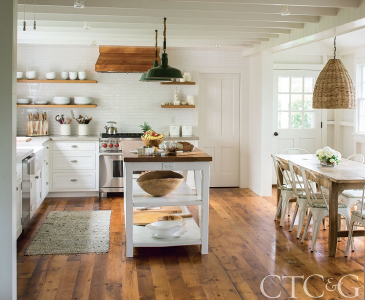 farmhouse style kitchen with beams and open shelving