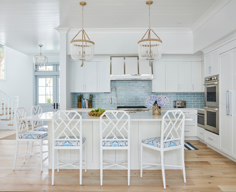 Welcoming Kara Hebert Interiors kitchen with hanging pendants over island