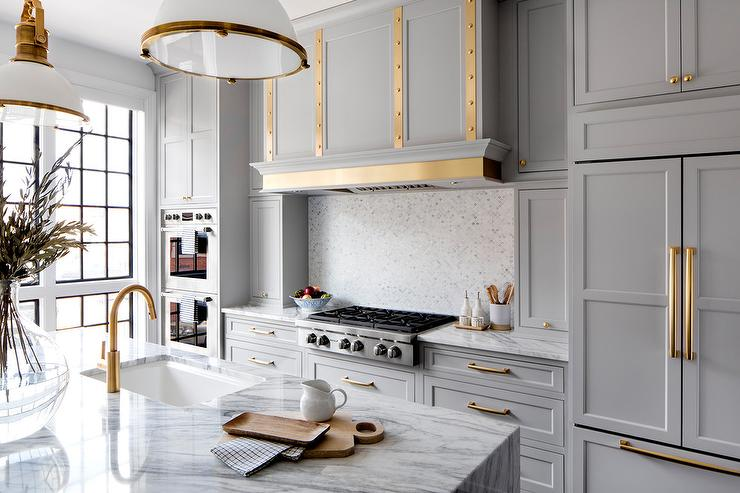 gold faucets and pulls in kitchen with Bria Hammer