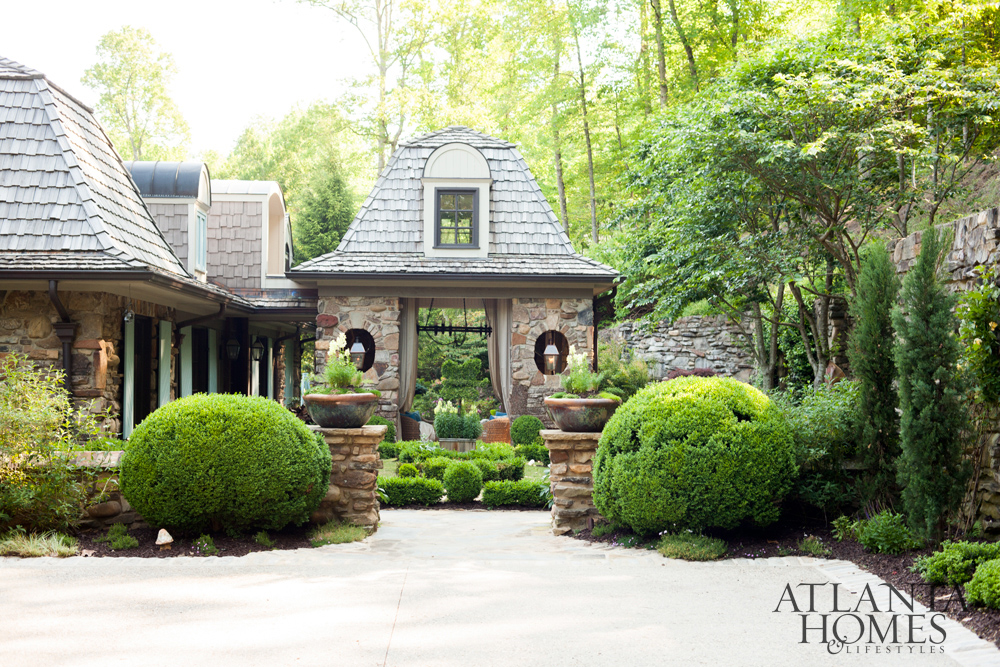 rustic curb appeal in this stone house by Meridy King