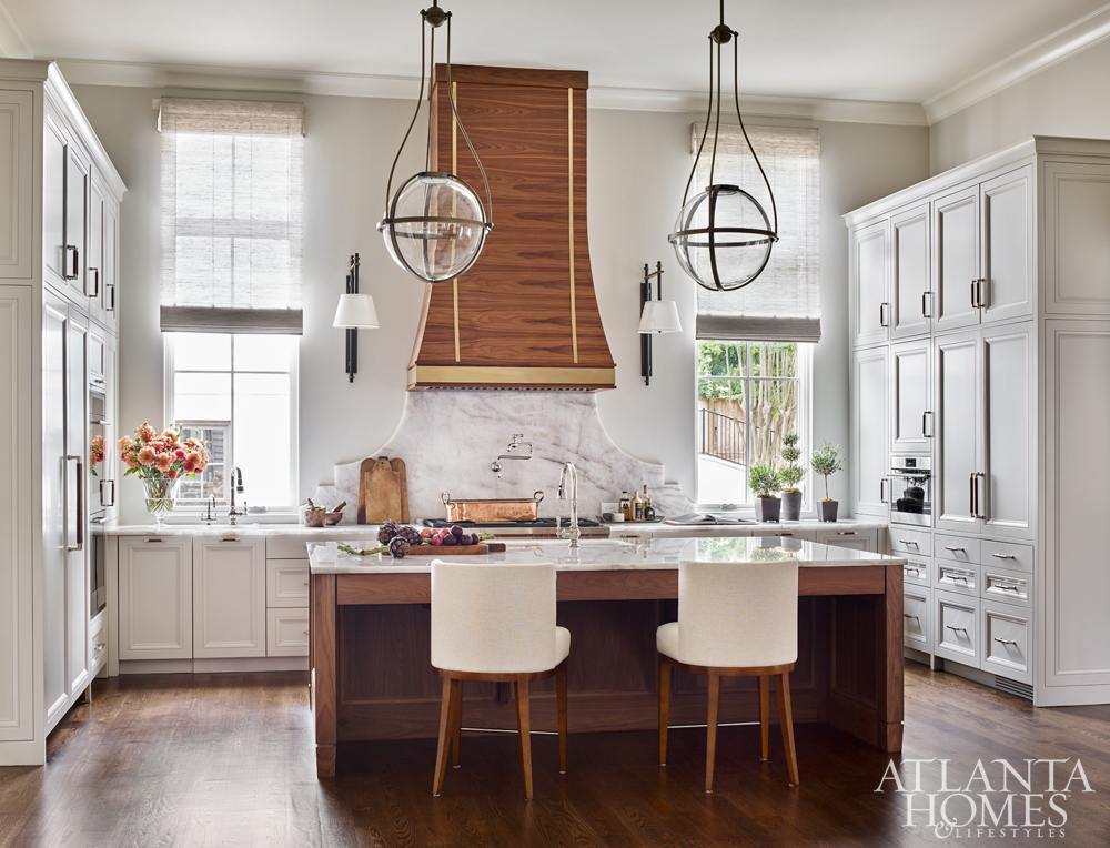 kitchen design winners marble island with wood range hood and round pendants over island