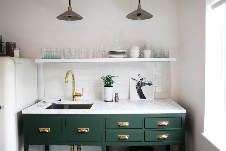 Katie Hackworth green cabinets in office with brass hardware and faucet
