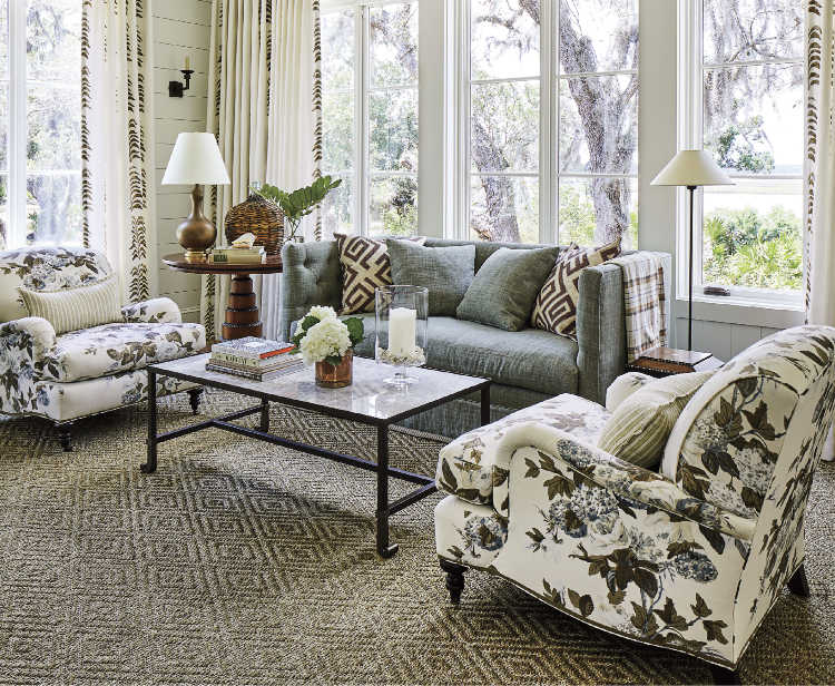 Southern Living Idea House by Heather Chadduck living room with pair of chairs and natural fiber rug