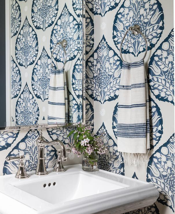 tiny powder room with blue and white wallpaper Marianne Simon