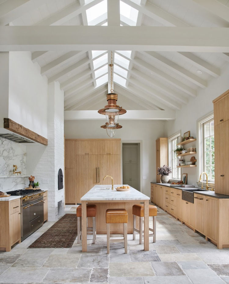 blonde wood cabinets in kitchen of Amber Interiors