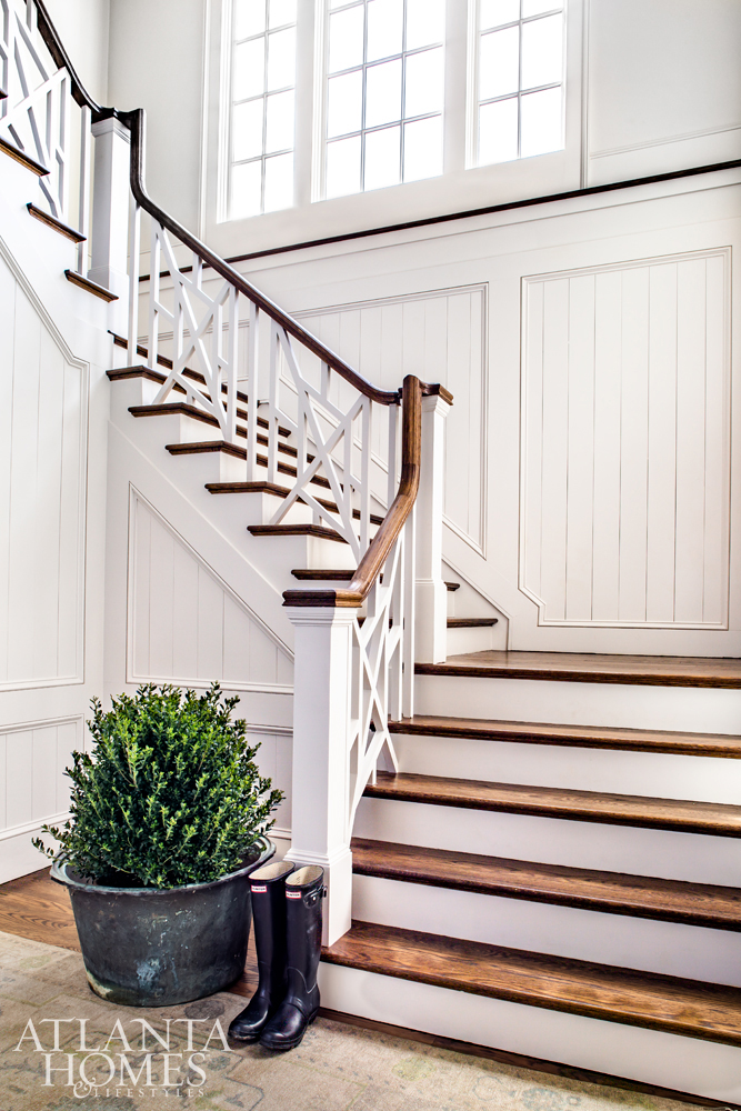 talented team of Brandon Ingram Design entry foyer with chippendale rail staircase