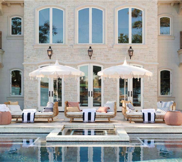 pool area with pool umbrellas and chairs from Serena & Lily and pillow mix