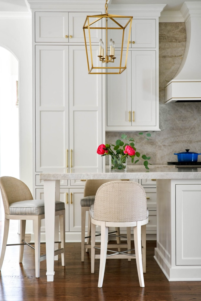 JENkins Interiors kitchen with wicker stools and lantern