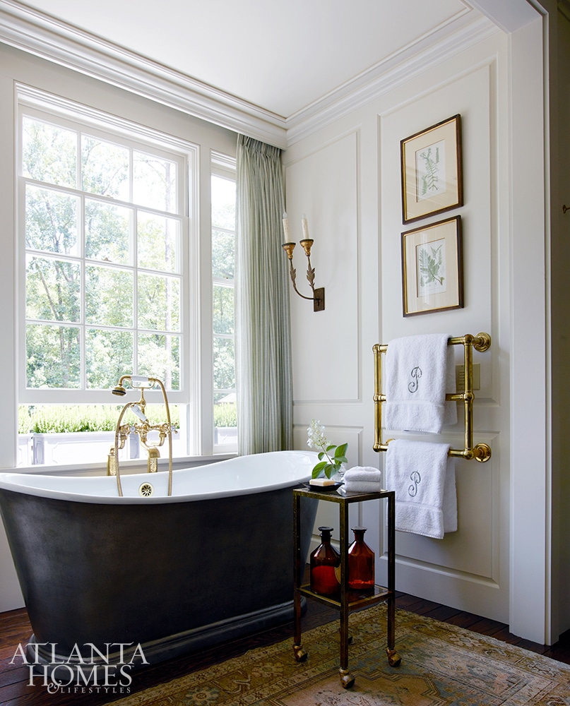 Tammy Connor Design Georgian Revival bathroom with brass towel warmer