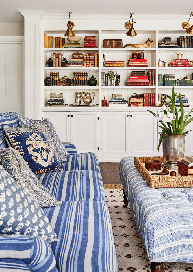 Meredith Ellis Design blue and white living room with brass library lights