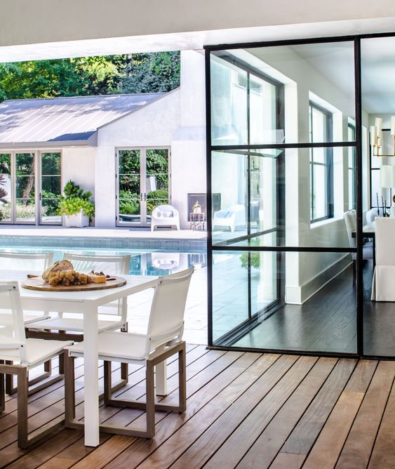 Nancy Duffey Interiors | Jeff Herr Photography outdoor area with pool and covered porch