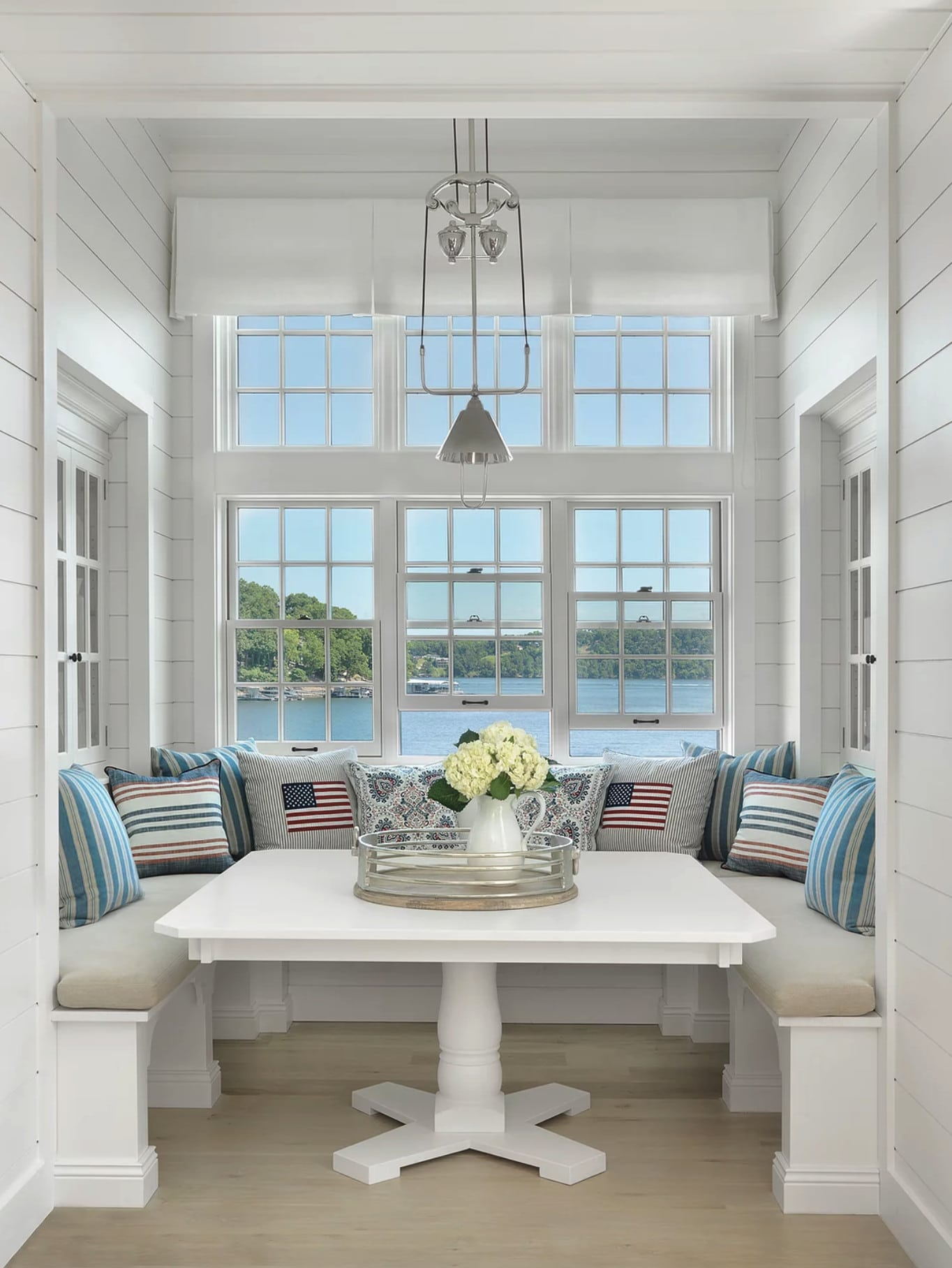 Nantucket house tour by Amy Studebaker Interior Design - Alise O'Brien Photography dining nook with banquette