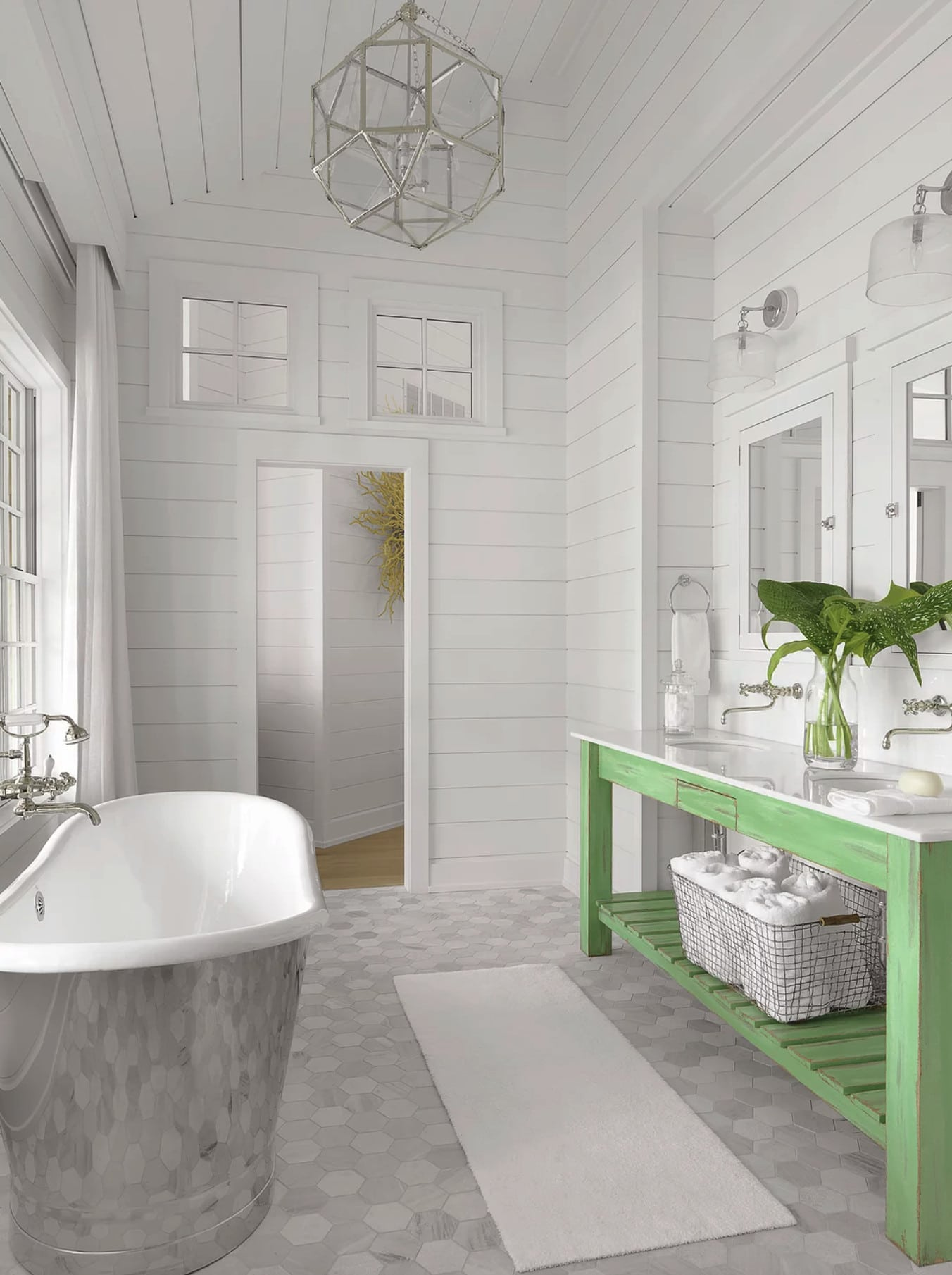 Nantucket house tour by Amy Studebaker Interior Design - Alise O'Brien Photography bathroom with freestanding stainless tub